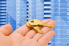 Hand giving keys Royalty Free Stock Image