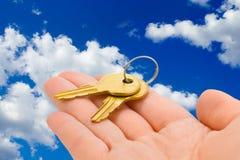 Hand giving keys Stock Photography