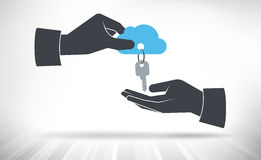 Hand giving keys to cloud. Royalty Free Stock Images