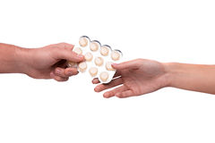 Hand giving lozenges in blister Stock Images
