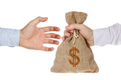 Hand giving a money bag. Isolated on white background Stock Images