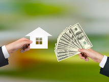 Hand giving money for housing Stock Photography