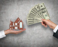 Hand giving money for housing Royalty Free Stock Image
