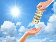 Hand giving money to other hand Royalty Free Stock Photos