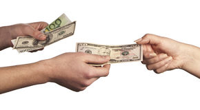 Hand giving money to other hand. Hand handing over money to another hand isolated on white background Stock Images