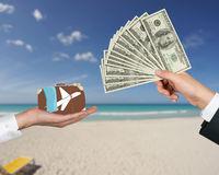 Hand giving money for travel Royalty Free Stock Photos