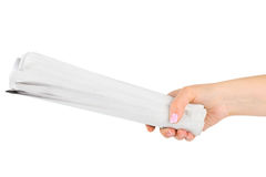 Hand giving newspapers Royalty Free Stock Photography