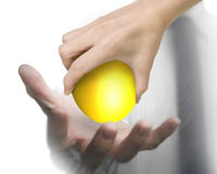 Hand giving one golden egg Royalty Free Stock Photo