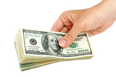 Hand giving pack of $100 banknotes Stock Images