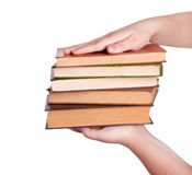 Hand giving pile of book Royalty Free Stock Photos