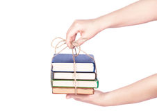 Hand giving pile of book Stock Photos