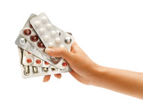 Hand is giving pills plates Royalty Free Stock Photo