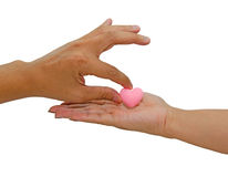 Hand giving pink heart isolated Stock Photography