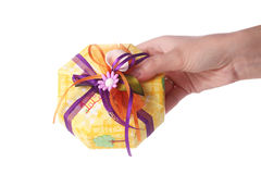Hand giving a present Stock Photography