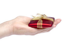 Hand giving present Royalty Free Stock Photo