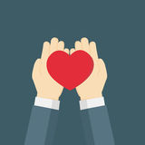 Hand giving the red heartlove. Businessman hand holding the red heart Stock Image