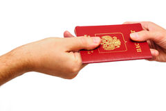 Hand giving Russian passport to other person Stock Images