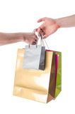 Hand giving shopping bags Royalty Free Stock Photography