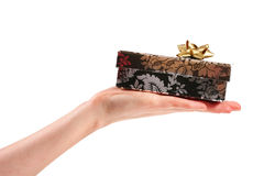 Hand Giving Small Gift Stock Photo