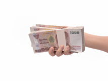 Hand giving Thai banknotes. Isolated on white background Stock Photo