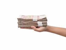 Hand giving Thai banknotes. Isolated on white background Stock Photography