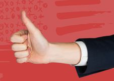 Hand giving thumbs up against red hand drawn american flag Stock Images