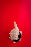 Hand Giving Thumbs Up On Red Royalty Free Stock Images