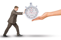 Hand giving timer to businessman Stock Image