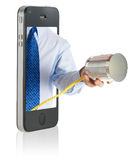 A hand giving a tin can phone. Through a smart phone Royalty Free Stock Image