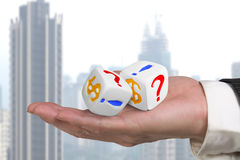 Hand giving two white dices Stock Photography