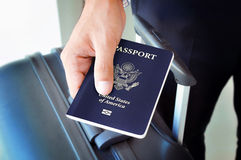 Hand giving U.S. passport Royalty Free Stock Photo