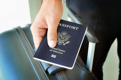Hand giving U.S. passport Royalty Free Stock Image