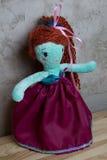 Hand - gjord docka och kläderleksak Fotografering för Bildbyråer