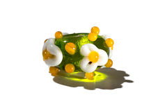 Hand - gjord gräsplan med den glass pärlan för blommor Arkivfoto