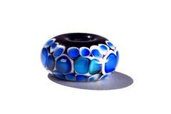 Hand - gjord svart och blå glass pärla Arkivbilder