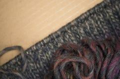 hand - gjort stuckit tyg för melange ull Arkivfoto