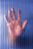 Hand on Glass Royalty Free Stock Image