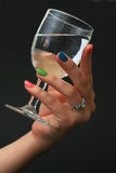 Hand and glass Stock Photography