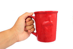 Hand with glass. Hand holding a red glass on white background Royalty Free Stock Photo