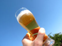 Hand with glass of beer Royalty Free Stock Images