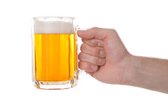 Hand with glass of beer stock photography
