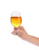 Hand with glass of beer. Royalty Free Stock Image