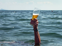 Hand with a glass of beer Royalty Free Stock Photography