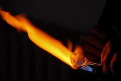 Hand of a glass blower heating a. Free-blowing is a glass blowing technique now mainly used for artistic purposes. It involves blowing puffs of air into a molten royalty free stock photography