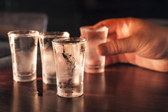 Hand with a shot glass of vodka. Royalty Free Stock Photo