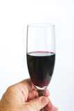 Hand with glass of red wine Stock Photos