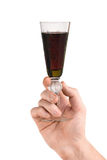 Hand with glass of red wine Stock Images
