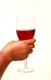 Hand with glass of red wine Royalty Free Stock Image