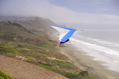 Hand glider by seascape cliff Stock Photo
