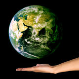 Hand with globe. Hand holding the globe isolated on black Stock Photo